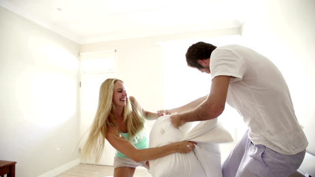Couple fighting with pillows video
