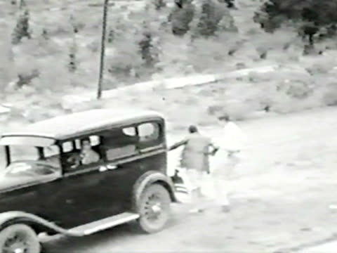 Couple fights over front seat--From 1930's film video
