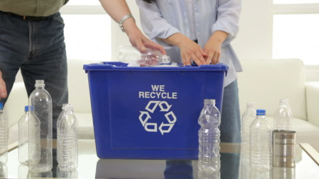 Couple fills recycle bin, closeup video