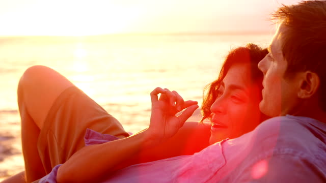 Couple gaze at sunset video