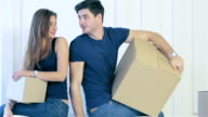 Couple girl and the guy kept moving boxes in hands video