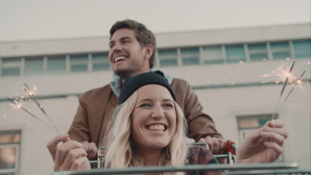 Couple haveing fun with shopping cart video