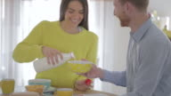 Couple having a breakfast and pouring milk video