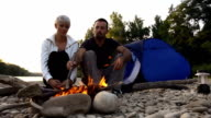 HD SUPER SLOW-MO: Couple Having A Campfire video