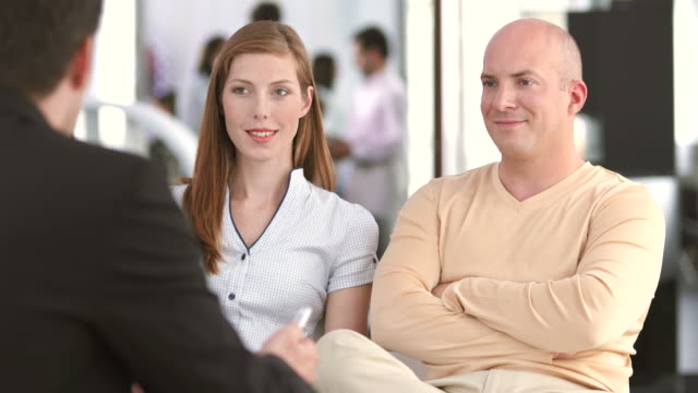 HD: Couple Having A Conversation In The Bank video