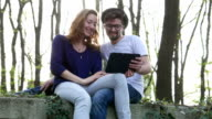 Young happy couple having a video chat and showing engagement ring video