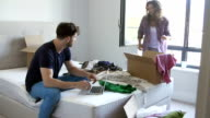 Couple Having Argument As Woman Packs To Leave video
