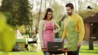 Couple having barbecue video