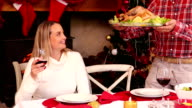 Couple having christmas dinner together video