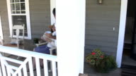 Couple having coffee on porch video