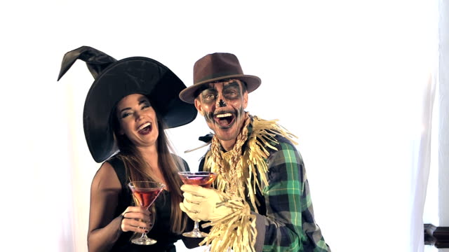 Couple having fun at adult Halloween costume party video