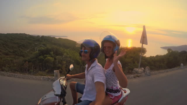 POV Couple having fun riding a scooter video