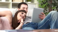 HD DOLLY: Couple Having Fun Using Tablet At Home video
