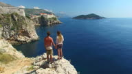 Couple holding hands on a cliff with a view of Old Town of Dubrovnik video