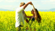 Couple hug and dance in a field video