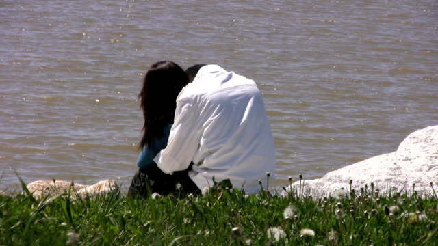 Couple Hugging By Water's Edge - Close Up (HD 1080p30) video