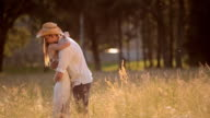 SLO MO Couple hugging each other in the sunny meadow video