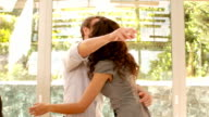 Couple hugging in new home video