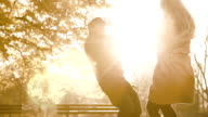 Couple in a romantic attitude in a park during Autumn video