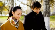Couple in a wonderful mood to walks in the autumn city video