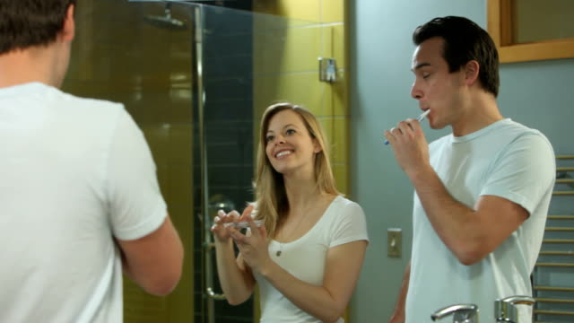 Couple in bathroom getting ready for day video