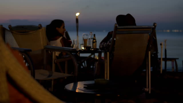 Couple in cafe by the sea video