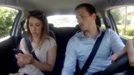 Couple in car texting sms video