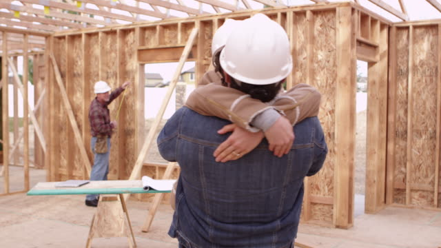 Couple in front of construction video