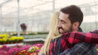 Couple in greenhouse video