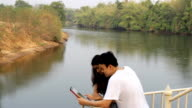 couple in holidays and tablet technology video