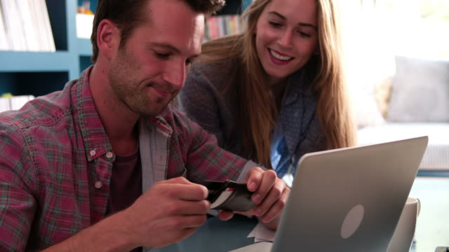Couple In Home Office Making On Line Purchase video