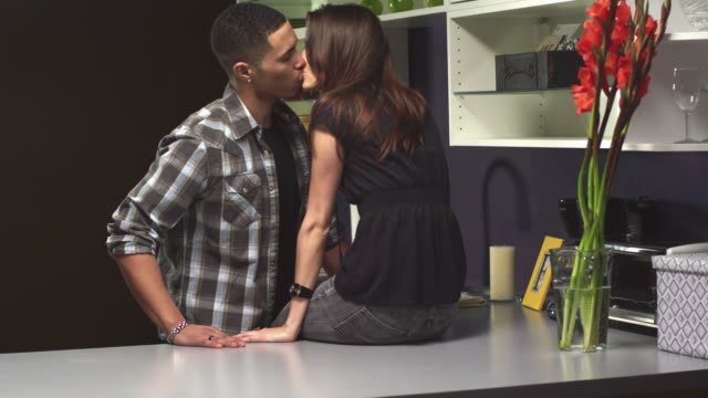 Couple in kitchen kiss video