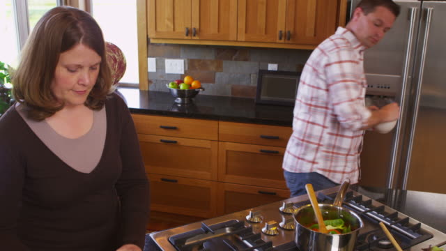 Couple in kitchen together prepare meal video