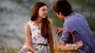 couple in love at a picnic fed each other grapes video