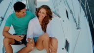 Couple in love drinking champagne on the yacht. video