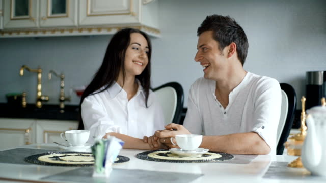 Couple in love having breakfast together in the kitchen video