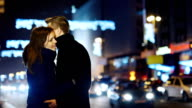 Couple in love on the background of night traffic video