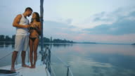 Couple in love relaxing on a yacht. video