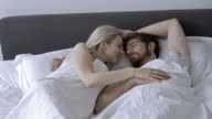 Couple in love sleeping and partner being very affectionate video