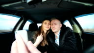 Couple in love taking selfie in car while driving video