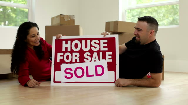 Couple in new home with sign video