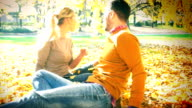 Couple in park on autumn day. video
