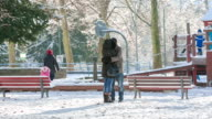 couple in park on sunny winter day video