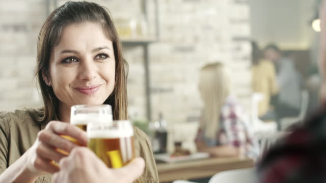 Couple in the restaurant drinking beer video