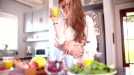 Couple in their kitchen for breakfast in the morning video