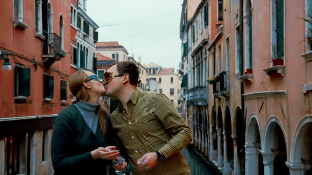 Couple in Venetian Masks Throwing Confetti video
