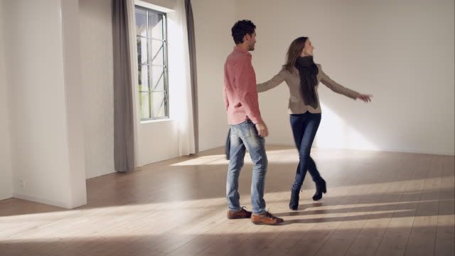 Couple inspecting new apartment video