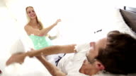 Couple is kissing after pillow fight video
