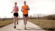 SLO MO TS Couple jogging and talking video