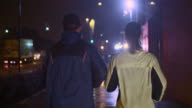 SLO MO TS Couple jogging in city at night video